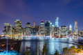 Manhattan skyline at night seen from brooklyn height promenade Stock Image