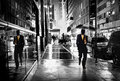 Manhattan street by night businessman with umbrella on a wet Royalty Free Stock Photos