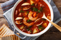 Manhattan tomato clam chowder soup close-up in a saucepan. horiz Royalty Free Stock Photo