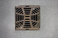 Manhole cover metal storm drain with warnings Royalty Free Stock Photos