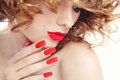 Manicure and lipstick close up portrait of young beautiful woman with stylish red selective focus Royalty Free Stock Photos
