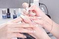 Manicure master make nail extension drawing of the last layer of gel Royalty Free Stock Photo
