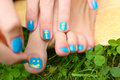 Manicure and pedicure on the green grass lawn background Royalty Free Stock Photo
