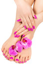 Manicure and pedicure with a orchid flower Royalty Free Stock Photo
