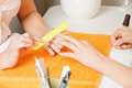 Manicure process on female hands closeup picture of Royalty Free Stock Images