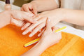 Manicure process on female hands closeup picture of Royalty Free Stock Photography