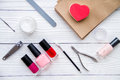 Manicure set and nail polish on wooden background Royalty Free Stock Photo