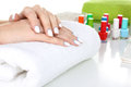 Manicure the woman doing the and the nail polish color a lot of colorful nail polish closeup Royalty Free Stock Photo