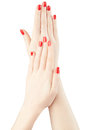 Manicure on woman hands with red nail polish Royalty Free Stock Photo