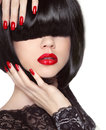 Manicured nails red lips black bob hairstyle brunette girl with short healthy hair on white studio background Stock Images