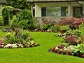 Manicured yard a beautifully arranged flower garden and residential Stock Image