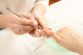 Manicurist Removing Cuticle From The Nails Royalty Free Stock Photo