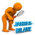 Manikin loupe annual balance orange cartoon character with german text jahresbilanz translate Royalty Free Stock Photo