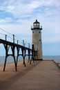 Manistee pier lighthouse on lake michigan the sits at the end of the and the catwalk above leads to the access door Stock Image