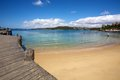 Manly beach nsw australia in new south wales wooden wharf with sand and ocean Royalty Free Stock Photo