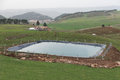 The manmade pool for agriculture by using plastic sheet to protect water leak out to ground in ifrane city morocco Royalty Free Stock Image