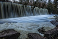 Manmade waterfall with stones and foam in the foreground dam at hirsky tikych river ukraine buki Royalty Free Stock Photos
