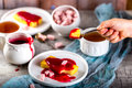 Manne cake with raspberry jam on a white plate. Tea party. Royalty Free Stock Photo