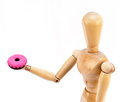 Mannequin holding doughnut Royalty Free Stock Photography
