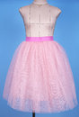 Mannequin in pink princess skirt on blue background Royalty Free Stock Photo