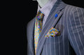 Mannequin in purple striped suit yellow silk tie handkerchief close up of a shirt and Royalty Free Stock Image