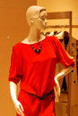 Mannequin with red dress photoed outside a shop window Royalty Free Stock Photography