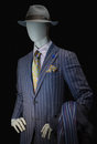 Mannequin in striped suit and hat purple shirt yellow silk tie handkerchief gray clipping path included Royalty Free Stock Photos