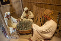 Mannequins depicting scene of old muslim men drinking tea near the fire