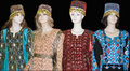 Mannequins displaying traditional turkish costumes four wearing colorful with headdresses black background Royalty Free Stock Images
