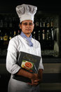 Manpower in hospitality industry a young woman working india is standing front of bar counter of a hotel india quality of Royalty Free Stock Photography