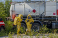 Mans with briefcase in protective hazmat suit workers Stock Image