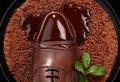 Mans brown shoe in hot chocolate Royalty Free Stock Photos