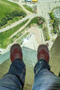 Mans feet on the glass floor of the CN tower Royalty Free Stock Photo