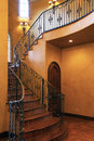 Mansion home interior front stairway entrance Royalty Free Stock Photo