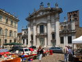 Mantua cathedral a flea market in a square outside the of saint peter in lombardy northern italy goes back to the Royalty Free Stock Image