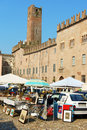Mantua flea market in piazza sordello italy june italy some people around the background torre della gabbia cage tower Stock Images