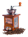 Manual coffee grinder with beans isolated on white background Royalty Free Stock Photo