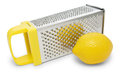Manual grater with yellow handle and lemon on white background Royalty Free Stock Images