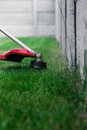 Manual lawn mower on the background of green grass