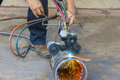 Manual pipe cutting with oxy acetylene Stock Images