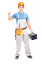 Manual worker holding a tool box and giving a thumb up Stock Images