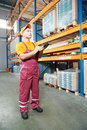 Manual worker inspector in warehouse Stock Photography