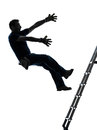 Manual worker man falling from ladder silhouette Royalty Free Stock Photo