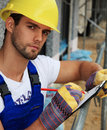 Manual worker taking minutes Royalty Free Stock Image