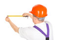 Manual worker tape measure over white background Stock Photos