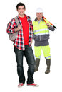 Manual worker and teenager Royalty Free Stock Images