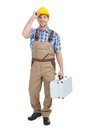 Manual worker with toolbox full length portrait of young over white background Stock Photos