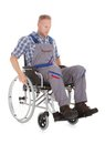 Manual worker in wheelchair full length of over white background Royalty Free Stock Photos