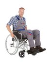 Manual worker in wheelchair full length of over white background Stock Images