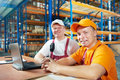 Manual workers in warehouse Royalty Free Stock Image
